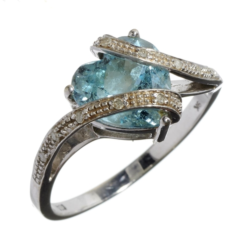 14 - <strong>A DIAMOND AND HEART SHAPED BLUE TOPAZ RING </strong>in white gold, marked 9k, 2.8g, siz...
