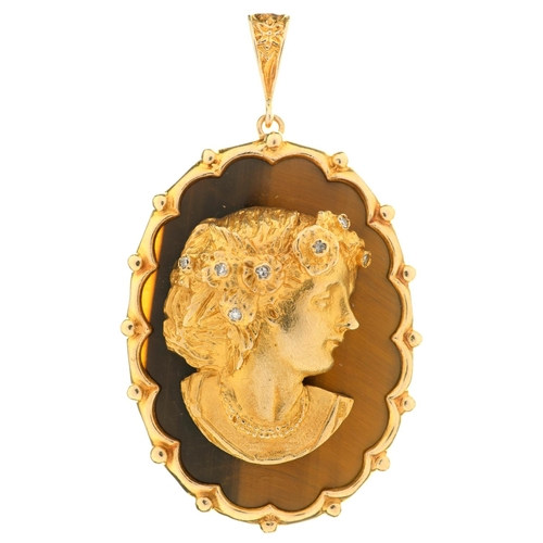 36 - <strong>A DIAMOND, TIGER'S EYE AND 9CT GOLD PENDANT</strong> designed as the head of a young woman...