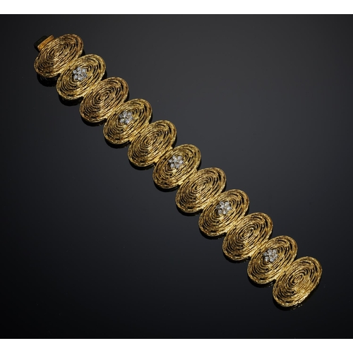 41a - <strong>A DIAMOND AND 18CT GOLD BRACELET BY BOODLES</strong> 20cm l, import marked London 1972, 84....