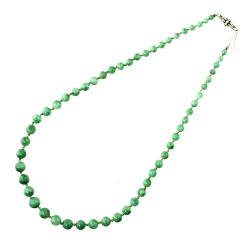 50 - <strong>A NECKLACE OF JADE BEADS WITH EMERALD AND DIAMOND CLASP, C1930 </strong> in platinum, beads ...
