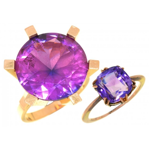 11 - <p>A SYNTHETIC PINK SAPPHIRE COCKTAIL RING the round faceted sapphire 18ct approx, in gold marked 58...
