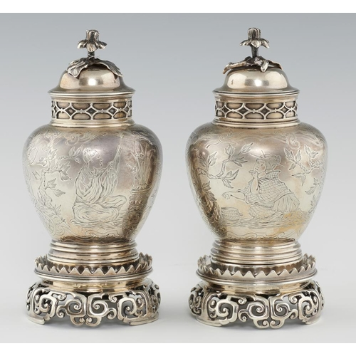140 - <p>A PAIR OF EDWARD VII CHINOISERIE ENGRAVED SILVER JARS, COVERS AND STANDS IN WILLIAM AND MARY STYL...