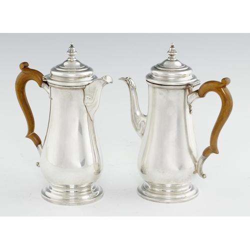 149 - <p>A PAIR OF GEORGE V BALUSTER SILVER CAFE AU LAIT POTS  22cm h, by Atkin Bros (Silversmiths) Ltd, S...
