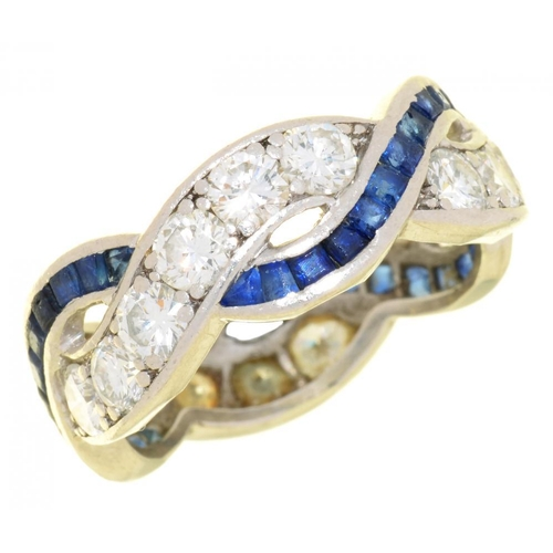 15 - <p>A SAPPHIRE AND DIAMOND TWIST RING  with calibre cut sapphires, in platinum, 6.5g, size M�</p><p><...