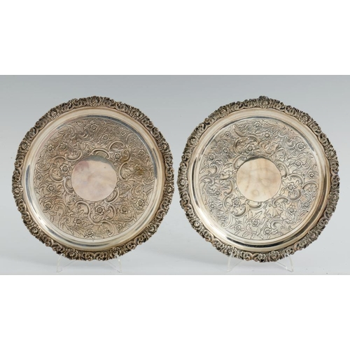 156 - <p>A PAIR OF GEORGE III SILVER WAITERS  flat chased with a wide band of flowers and rocaille in appl...