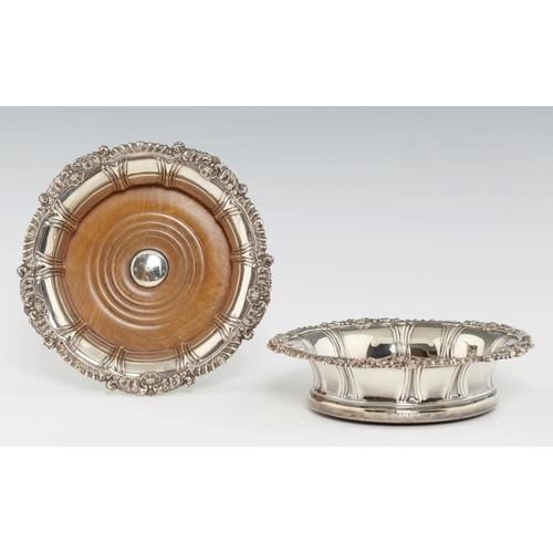 164 - <p>A PAIR OF VICTORIAN GADROONED SILVER WINE COASTERS  the rim with shells and scrolling foliage at ...