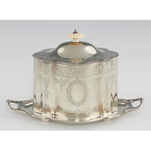 166 - <p>A VICTORIAN SILVER BISCUIT BOX   of straight sided serpentine form with beaded rims and engraved ...