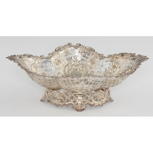 170 - <p>A VICTORIAN DIAPER PIERCED AND EMBOSSED SILVER FRUIT BOWL   on openwork foot, 36.5cm l, by Mappin...