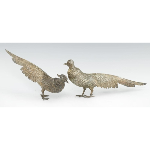 206 - <p>A PAIR OF IBERIAN SILVER PHEASANT TABLE ORNAMENTS  14cm h, maker MG  and Spanish control mark, 22...