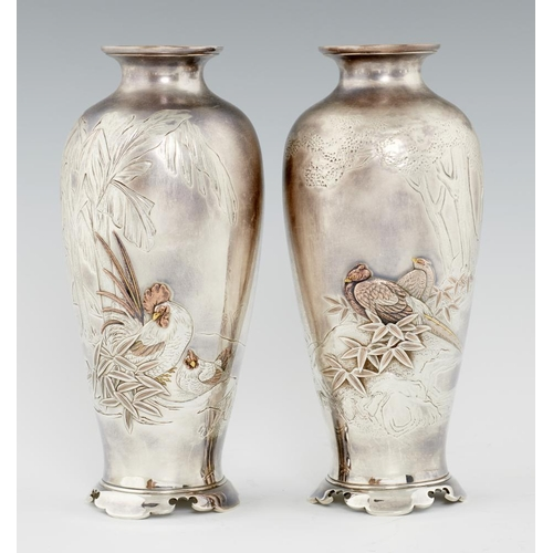 207 - <p>A PAIR OF JAPANESE SILVER AND MIXED METALS VASES, MEIJI PERIOD  finely carved and applied with co...