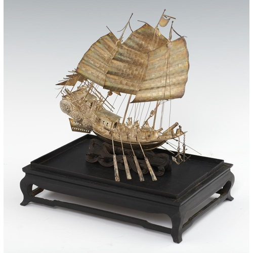 208 - <p>A CHINESE EXPORT SILVER MODEL OF A WAR JUNK, C LATE 19TH C  on wave carved wood stand, 24cm h, ma...