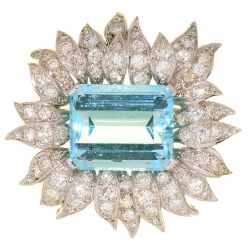 25 - <p>AN AQUAMARINE AND DIAMOND BROOCH  the step cut aquamarine in pav� set flower shaped surround, 3.5...
