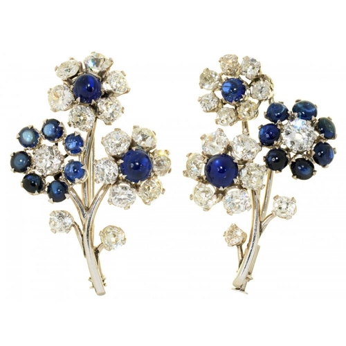 27 - <p>A PAIR OF SAPPHIRE AND DIAMOND BROOCHES  each in the form of three flowers composed of old cut di...