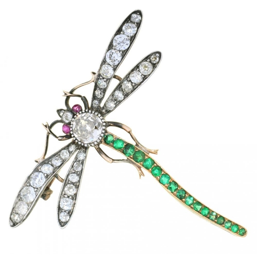 28 - <p>AN EDWARD VII DIAMOND AND EMERALD DRAGONFLY BROOCH, C1900  with ruby eyes, the collet SE</p><p>se...