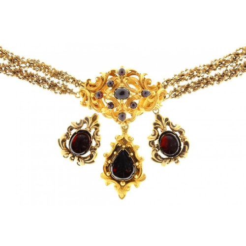 49 - <p>AN EARLY VICTORIAN FOILED GARNET AND GOLD NECKLACE, C1840  the leafy scrolling centre section wit...
