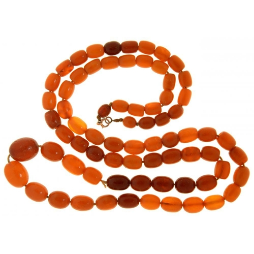 55 - <p>A NECKLACE OF SEVENTY TWO AMBER BEADS  87g</p><p></p>...