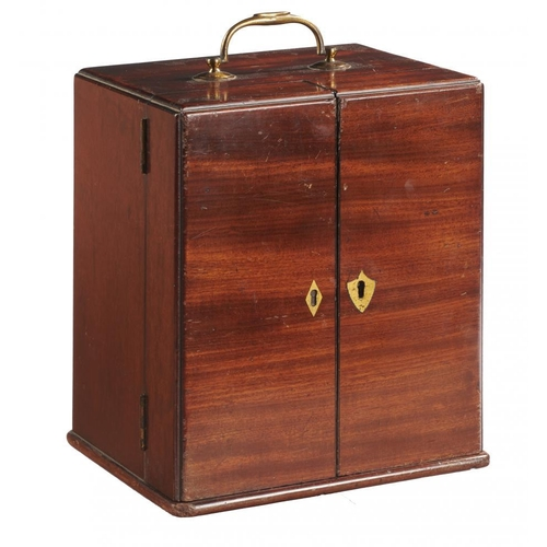 621 - <p>A VICTORIAN MAHOGANY DOMESTIC MEDICINE CHEST, MID 19TH C  the pair of doors revealing a fitted in...