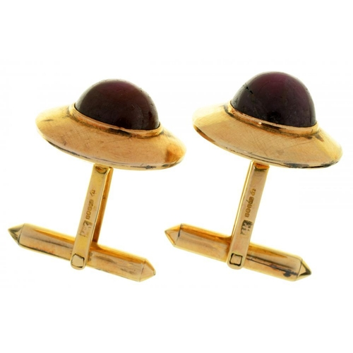 63 - <p>A PAIR OF STAR RUBY CUFFLINKS each cabochon ruby approx 6.5ct, to crosshatch textured gold mounts...