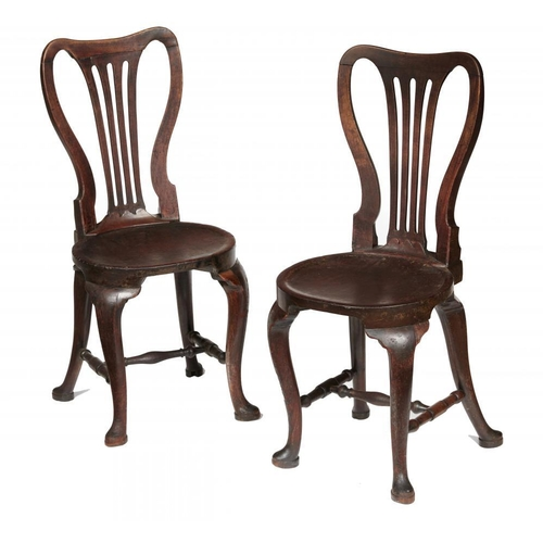773 - <p>A PAIR OF GEORGE II MAHOGANY HALL CHAIRS, C1750  with spoon back and dished, almost round seat, o...