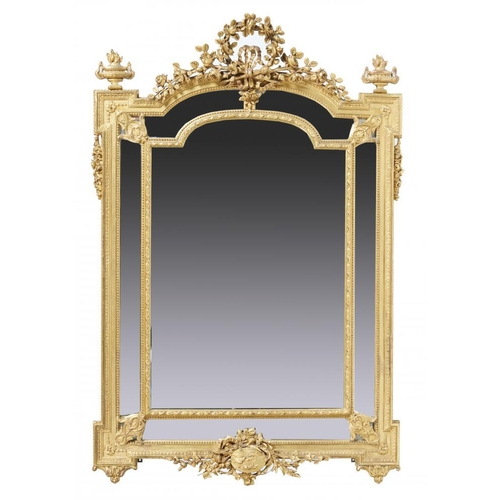 775 - <p>A FRENCH GILTWOOD AND COMPOSITION MIRROR IN LOUIS XVI STYLE, LATE 19TH C the breakarched frame cr...