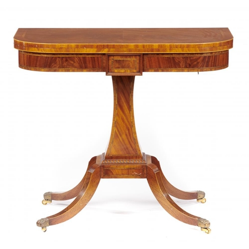 776 - <p>A MAHOGANY, TULIPWOOD AND LINE INLAID CARD TABLE, 20TH C  on brass paw castors, 78cm h; 45 x 89cm...