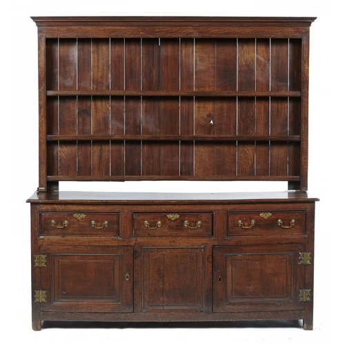 782 - <p>A GEORGE III OAK DRESSER, EARLY 19TH C  fitted with three drawers above three doors with raised-a...