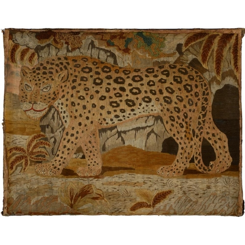 1002 - <p>A REGENCY EMBROIDERED PICTURE OF A LEOPARD, C1820  worked in wool mainly in long, short and chain...