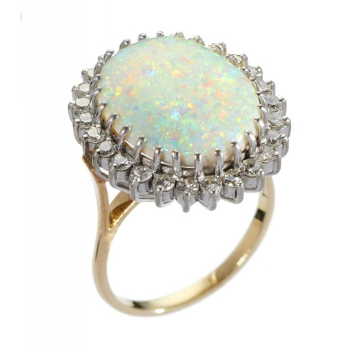 16 - <p>AN OPAL AND DIAMOND CLUSTER RING  1.9 x 2.2cm, in gold, marked 18ct,  9.5g, size R�</p><p></p>...