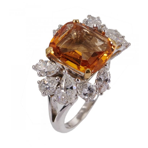 20B - <p>A TOPAZ AND DIAMOND RING the step cut topaz approximately 0.8 x 0.9cm between an asymmetrical arr...