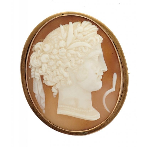 25 - <p>A CAMEO BROOCH, 19TH C  the oval shell carved with the head and emblem of Ceres, mounted in  gold...