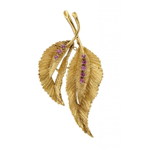 27 - <p>A RUBY BROOCH IN THE FORM OF TWO LEAVES  in 18ct gold, 5.4cm, import marked London 1963, 9.4g</p>...