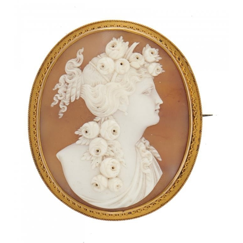 31 - <p>A CAMEO BROOCH, LATE 19TH C the oval shell carved with the head of a bacchante mounted in gold mo...