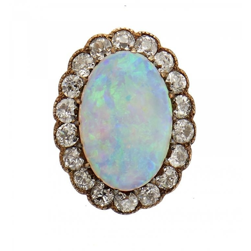 34 - <p>AN OPAL AND DIAMOND BROOCH, C1910  with old cut diamonds, in gold, 1.7cm l, 2.8g</p><p></p>...