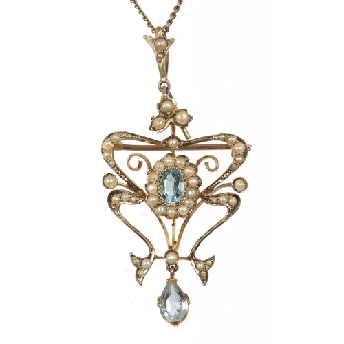 41 - <p>AN ART NOUVEAU AQUAMARINE AND SPLIT PEARL BROOCH-PENDANT, C1910  in gold, 5.2cm, on gold necklet,...