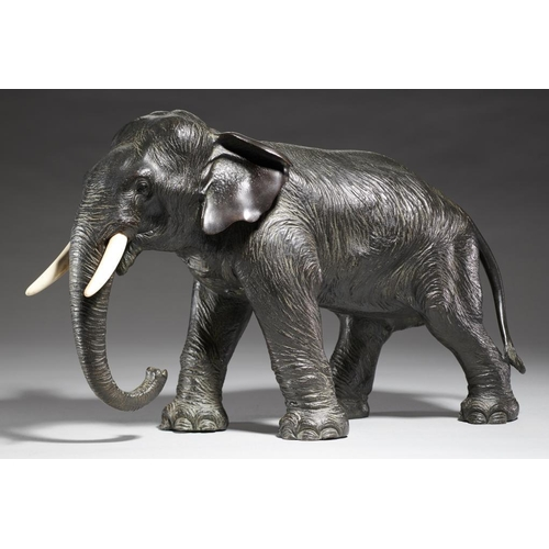 415 - <p>A JAPANESE BRONZE SCULPTURE OF AN ELEPHANT, MEIJI PERIOD  ivory tusks, rich even dark patina, 24....