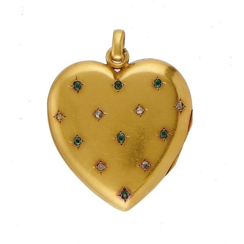 46 - <p>A HEART SHAPED GOLD LOCKET, C1900 the front set with a pattern of emeralds and rose diamonds, int...