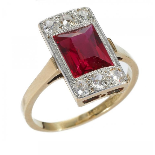 5 - <p>A STEP CUT RED STONE AND DIAMOND RING, C1930  millegrain set with old cut diamonds in gold, maker...