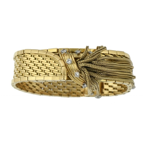 54 - <p>A FRENCH DIAMOND BRACELET in the form of a gold strap, with tassel 'knot', 1.5cm w, control mark ...