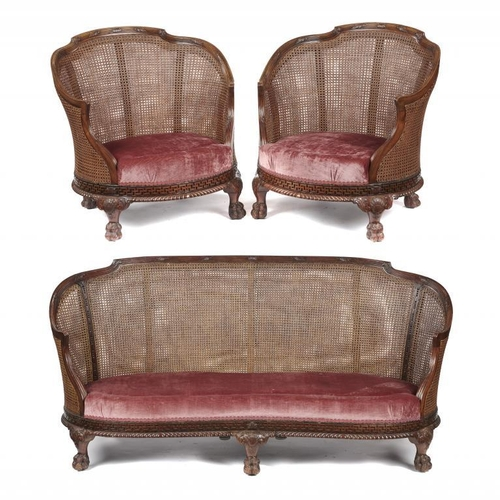 722 - <p>A GADROON CARVED SERPENTINE MAHOGANY BERGERE SUITE, C1930  the reeded frame with acanthus leaves ...