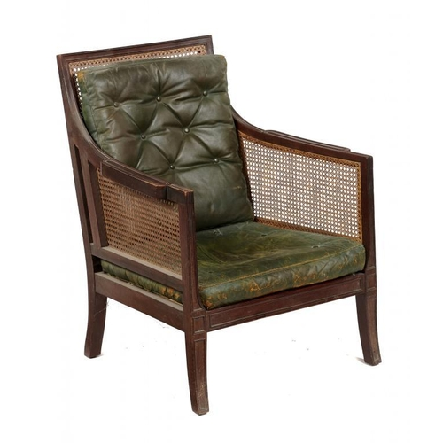 723 - <p>A VICTORIAN MAHOGANY AND CANED BERGERE, C1900  in Regency style, with two buttoned green hide squ...