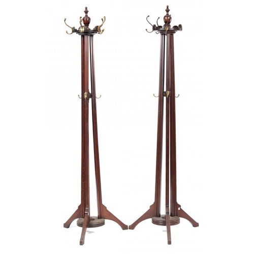 725 - <p>A PAIR OF MAHOGANY COAT STANDS, 20TH C  with brass hooks, 205cm h</p><p></p>...