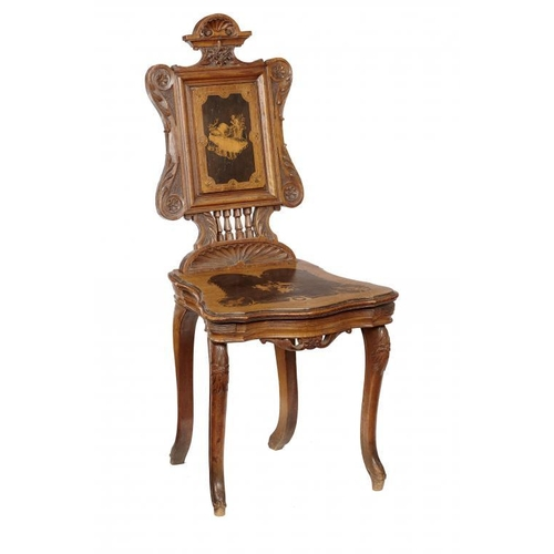 727 - <p>A SWISS CARVED, INLAID AND PENWORK DECORATED WALNUT MUSICAL CHAIR, LATE 19TH C the movement desig...