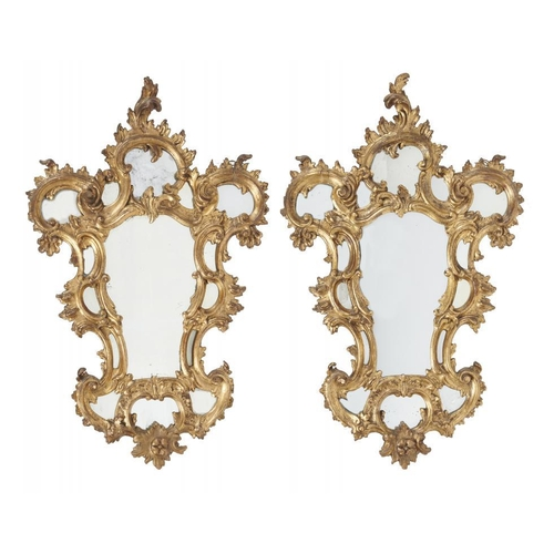 743 - <p>A PAIR OF ITALIAN GILTWOOD MIRRORS, 19TH C  carved with C scrolls and foliage, 107cm h, 66cm w</p...