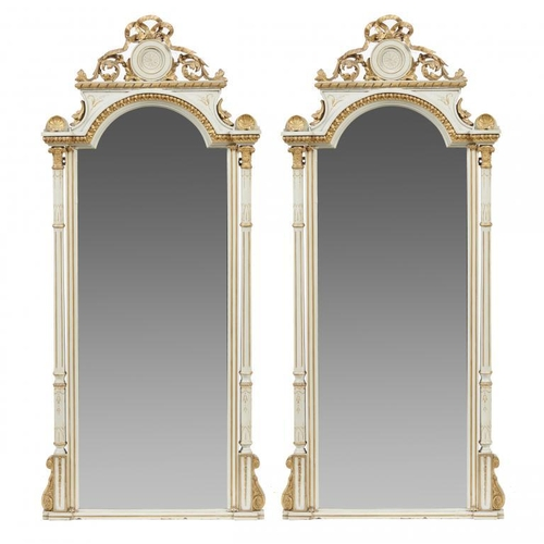 744 - <p>A PAIR OF GILT AND PALE GREY PAINTED WOOD AND COMPOSITION PIER MIRRORS, 19TH C  crested by foliag...