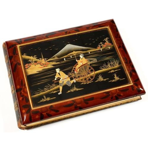 277 - <p>A JAPANESE LACQUERED PHOTO ALBUM, C1900 </p><p>containing 12 thick card leaves with cut-out mount...