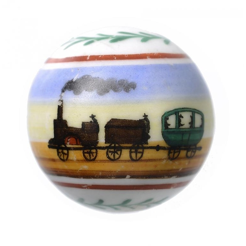 1035 - <p>VICTORIAN TOYS. A RARE PORCELAIN MARBLE PAINTED WITH A RAILWAY TRAIN, PROBABLY GERMAN, C1860   26...