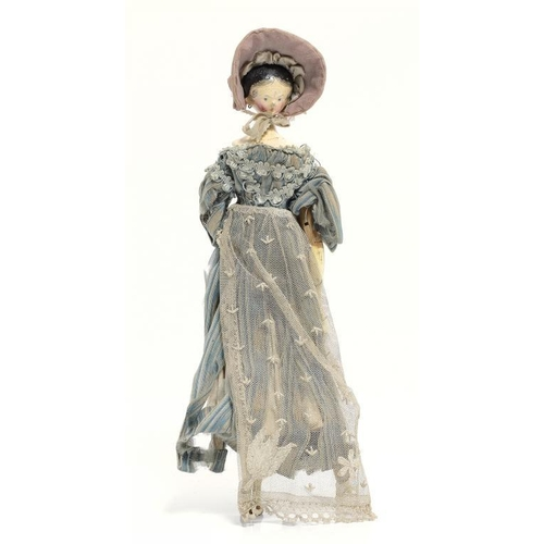 1040 - <p>AN ATTRACTIVE PAINTED WOOD PEG DOLL, 19TH C with finely painted shoulder-head, jointed wood body ...