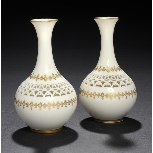 158 - <p>A PAIR OF ROYAL WORCESTER RETICULATED VASES BY GEORGE OWEN, 1913 10.5cm h, incised signature G Ow...