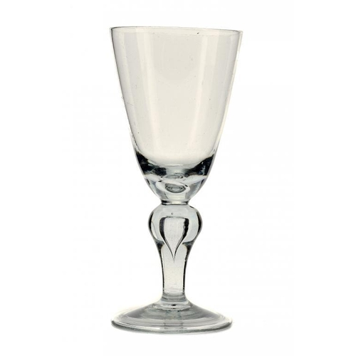 275 - <p>AN ENGLISH HEAVY BALUSTER GLASS GOBLET, C1700 the round funnel bowl with tear, on teared inverted...