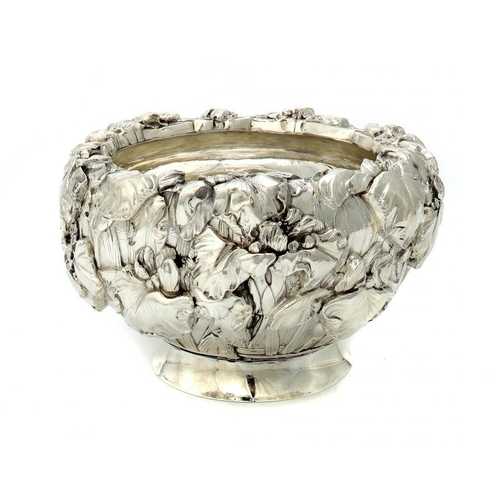 280 - <p>A JAPANESE SILVER OVOID BOWL  chased in high relief with irises, Meiji period, 25cm diam, marked ...